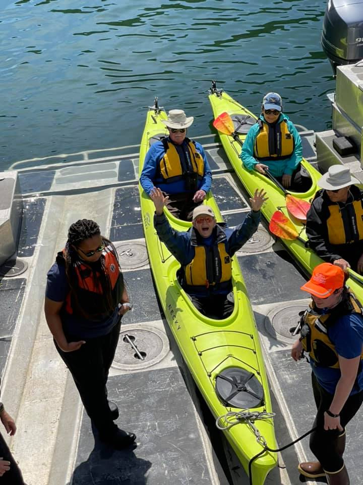 Naturalist Journeys' Uncruise Alaska guests staying high and dry into and out of their kayaks on the ship's stern